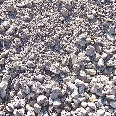 Close Up Image of road base construction aggregate, appearing as a mixture of small rocks and rock powder