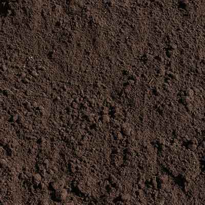 A closeup image of topsoil, a dark, nutrient rich, loose soil by Aggregates Now